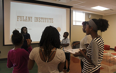 """Fulani Institute participants receive instructions for sharing self-composed poems """"Africa Is."""" (Photo credit: Joy Yala, master's student and Center of Pan-African Culture staff photographer)"""