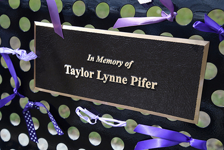 A plaque honors the memory of Kent State University student Taylor Pifer whose life was cut short in June 2017.
