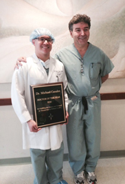 Michael Canales, D.P.M. (left), adjunct faculty member at Kent State University's College of Podiatric Medicine, is pictured with David Perse, M.D., president and CEO of St. Vincent Charity Medical Center.