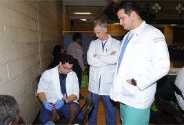 Staff and students from Kent State University's College of Podiatric Medicine examine the foot of a patient.