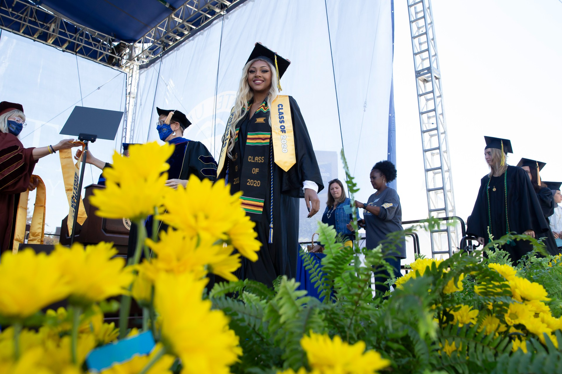Class of 2020 graduate crosses the stage at the Commencement ceremony