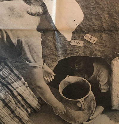 Newspaper clip: Kent State student Michael Campbell and Lucy McLaurin, of the University of Sydney, bring up a vase from one of the cemetery tombs. (clip provided by Holly Morris)