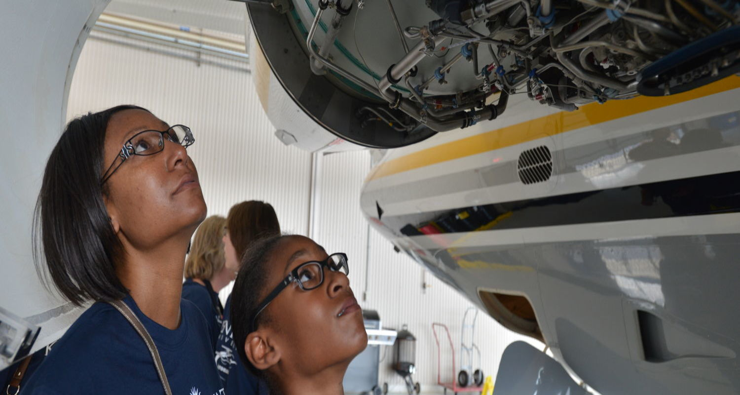 Students looking at aeroplane