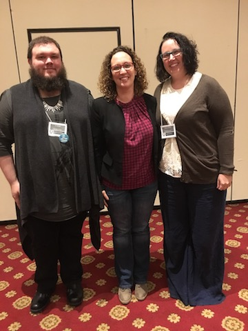 CJ Venable (left) and Meghan Brindley (right) pose with OVPES President Heybach after being recognized for their conference papers.