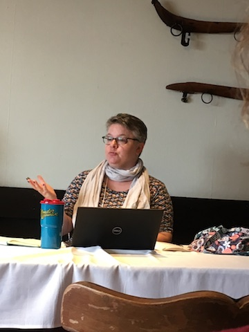 Danielle Weiser-Cline gestures as she speaks during her paper presentation at the OVPES conference.