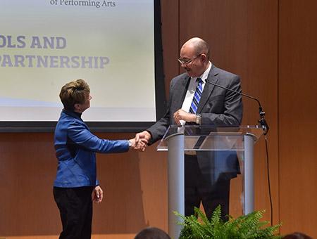 Kent State President Beverly J. Warren shakes hands with Akron Public Schools Superintendent David James.
