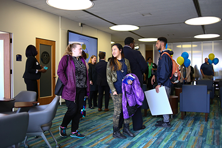 Kent State University students and staff mingle during the grand opening of the new Leadership Center.