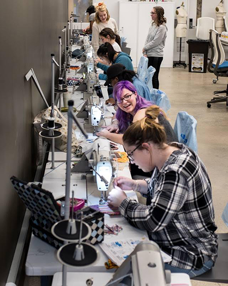 Kent State University Fashion School students create sanitary products for the Days for Girls kits during a sewing workshop.