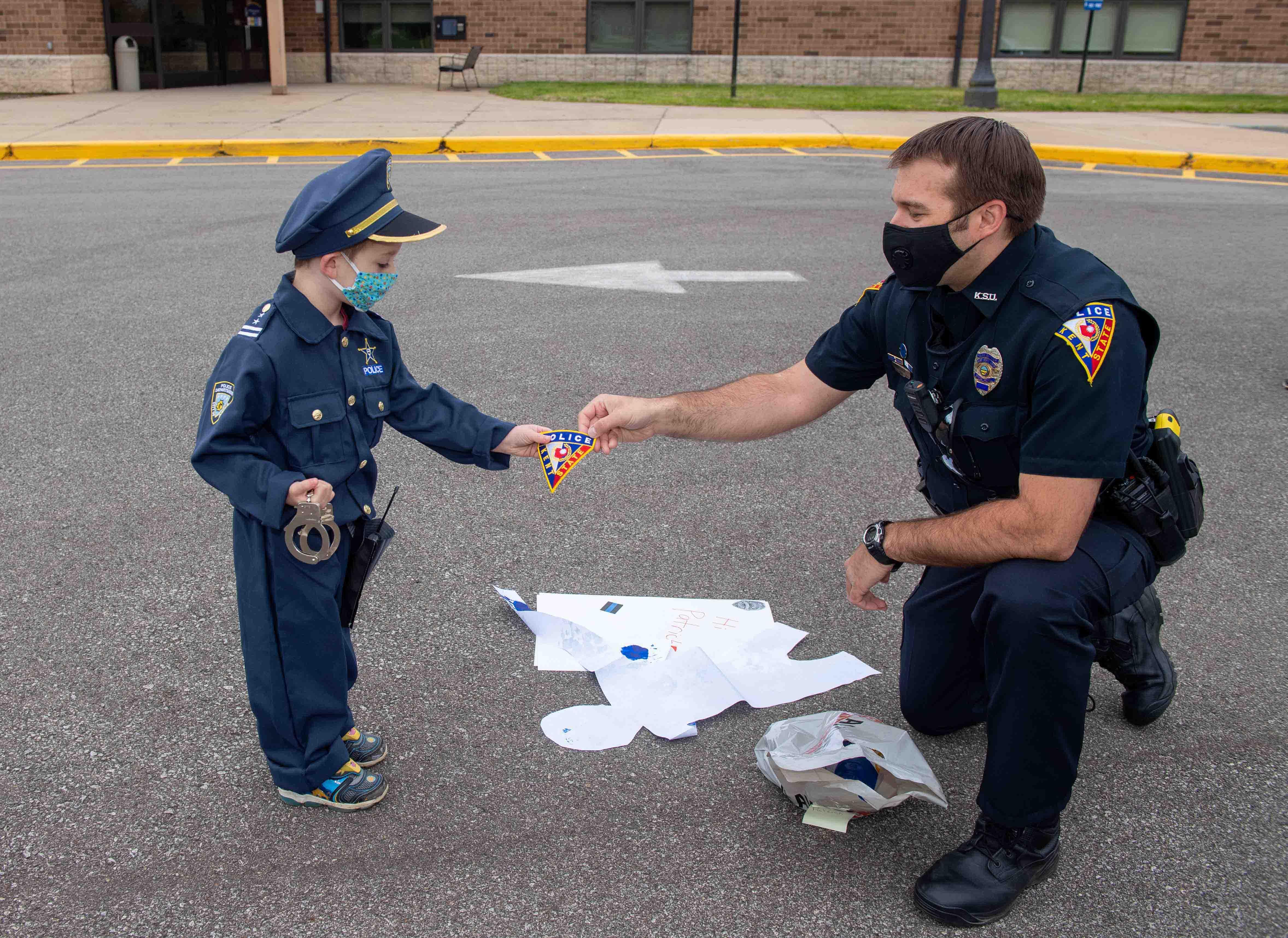 Patrick Tomaswick receives a police patch from Kent State Officer Joe Knotek