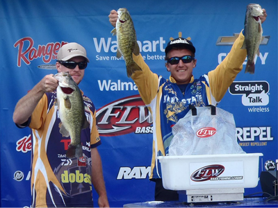 Greg Perry (left) and Trevor White display their fifth-place catch