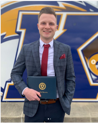 A Kent State University graduate from the Spring Class of 2020 stands with his diploma at Dix Stadium. (Photo credit: Instagram: @alex_barnard_)