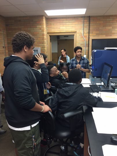 KSU Department of Geology graduate student Raihan Chowdhury showing Schumacher Elementary School 6th grade students how to use a Scanning Electron Microscope to collect images and chemical information on soil grains.