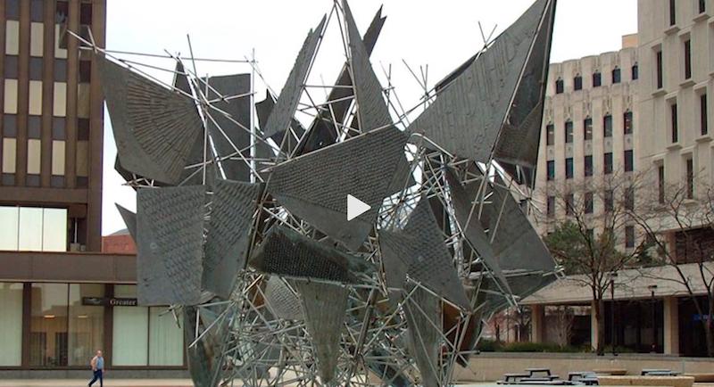 Screenshot from Applause public program of an abstract public sculpture of metal