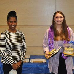 Stephanie Shaw, of the Marion G .Resch Foundation, presents a certificate and gifts to graduate Stephanie Vassar from East Liverpool High School.