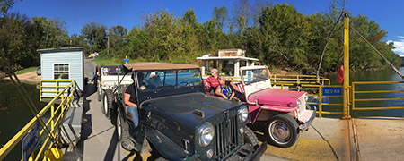 On a show and ride event in Kentucky, Bob Christy's Jeep is shown alongside a DJ3A surrey Jeep on a ferry crossing the Cumberland River, which divides Kentucky and Tennessee.