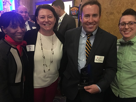 Representatives from Kent State's Division of Diversity, Equity and Inclusion, Vice President Alfreda Brown, Associate Vice President Dana Lawless-Andric, and Program Coordinator Katie Mattise celebrate with Ken Ditlevson after he received his award.