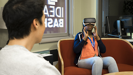 Amaraiah Peterson, a rising 10th grader from Akron's Kenmore-Garfield High School, experiences virtual reality for the first time during the Flash P'ACT summer program at Kent State.