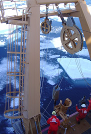 Researchers and Coast Guard techs aboard the icebreaker USCGC Healy prepare to deploy a piston core near the location off the Alaskan coast where the core in this study was recovered.