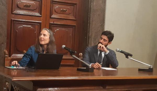 Dr. Sarah Harvey of Kent State, left, with Montecchio, Italy Mayor Federico Gori, in November, describing a possible Etruscan burial site found near the town in Summer of 2019.