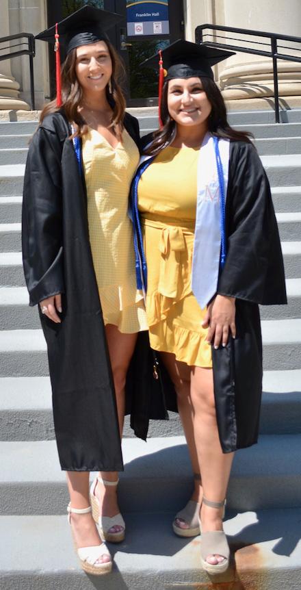 Devon Recktenwald (left)and Samantha Abraham (right) on the steps of Franklin Hall before graduation.