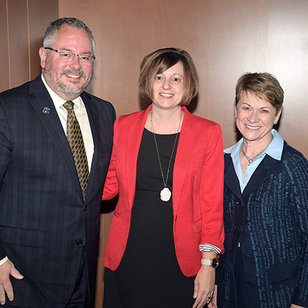 Sarah Sigler (center), associate director of prospect research in Prospect Management and Research, receives the 2018 President's Award of Distinction from Kent State University President Beverly J. Warren. They are pictured with Vice President for Institutional Advancement Stephen Sokany (left).