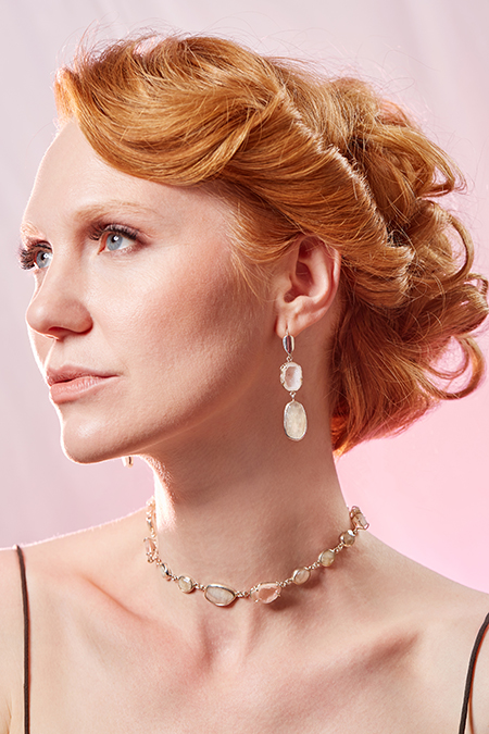 Photo of a model wearing earrings and a necklace made by Michelle Pajak-Reynolds