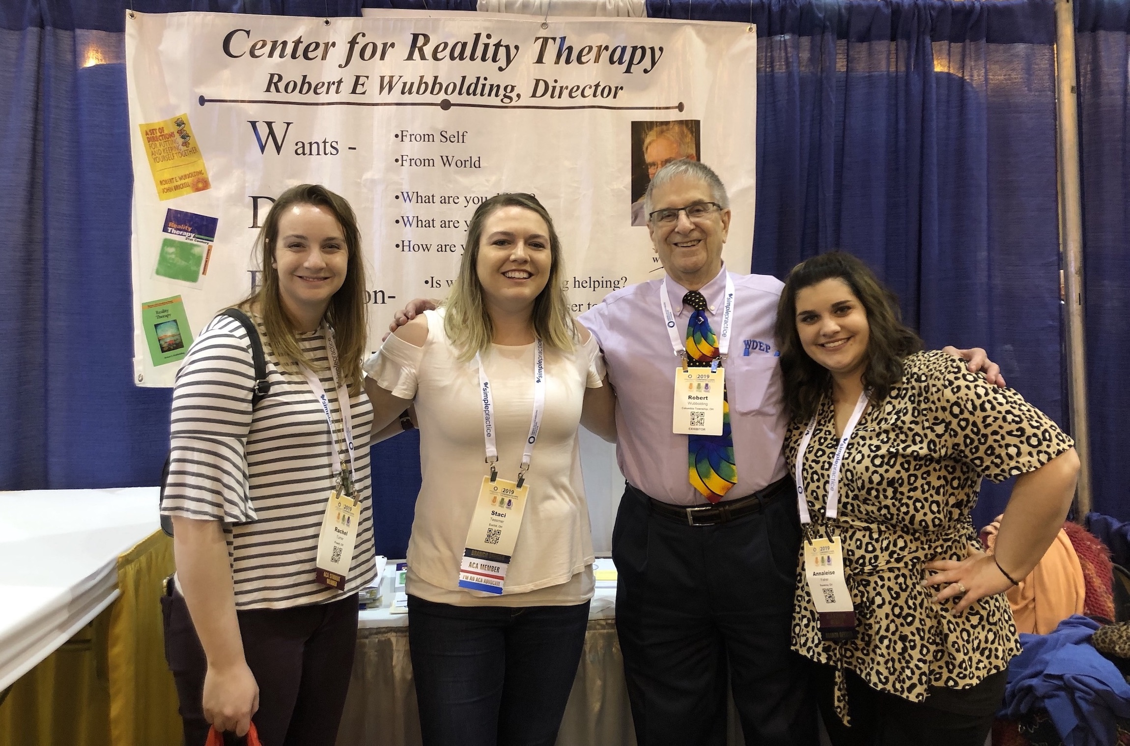 Staci Tessmer in a group at a conference