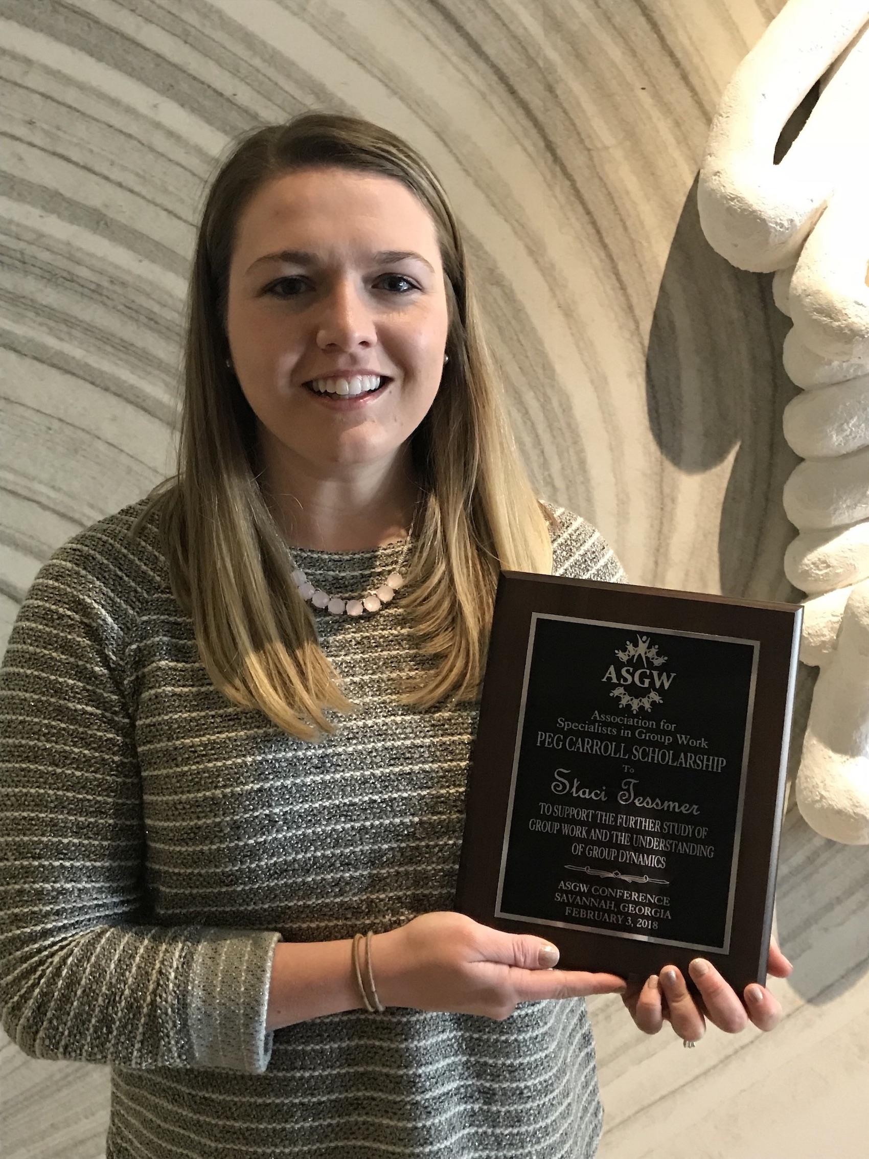 Staci Tessmer hold an award