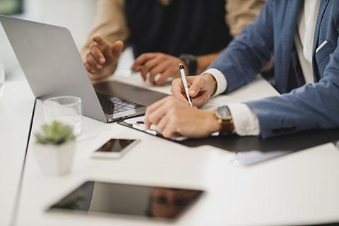 Business men at computer