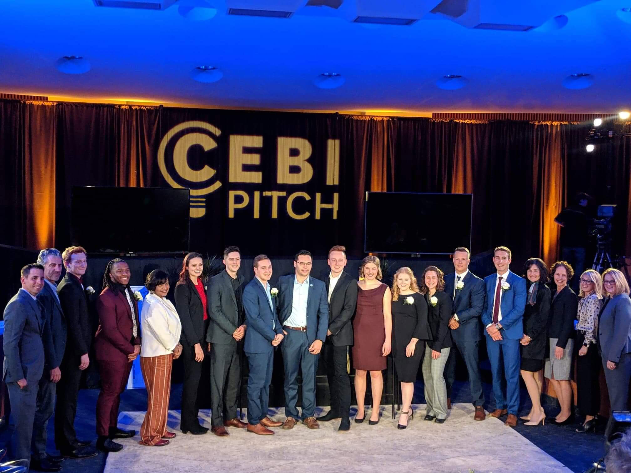 College of Business students at the CEBI Pitch competition, posed and smiling for the camera