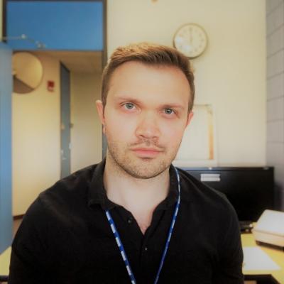 Headshot of Travis Feder