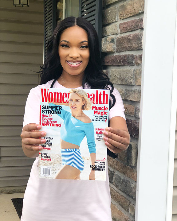 Women's Health magazine was the first publication to share Jones' COVID story. She poses for a photo with the magazine.
