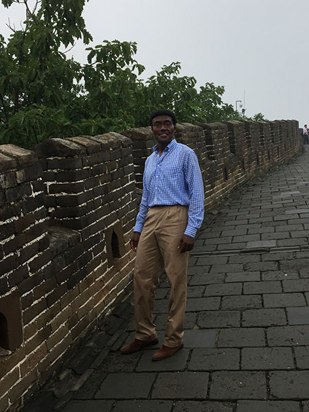 Pictured is Dr. Nettey after the arduous climb to the Great Wall of China this summer.