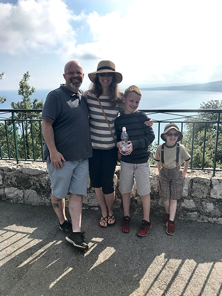 Jennifer Reeves and her family huddle together for a photo at a spot overlooking the Mediterranean from Castle Hill in Nice, France.