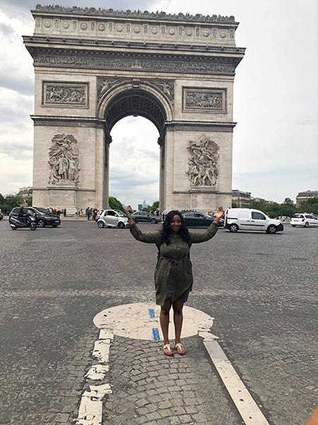 Nicole Brooks poses in front of Arc de Triomphe in Paris.