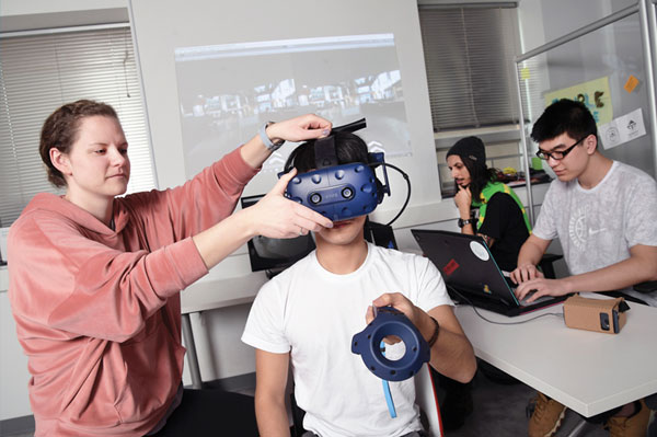 Students test virtual reality equipment.
