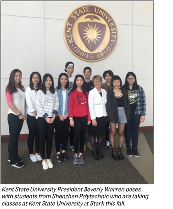 President Warren poses with Chinese students from Shenzhen Polytechnic.