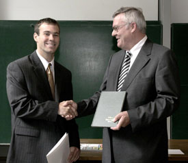 Dr. Wiant receives the Otto Lehmann Award at a ceremony in Karlsruhe, Germany.