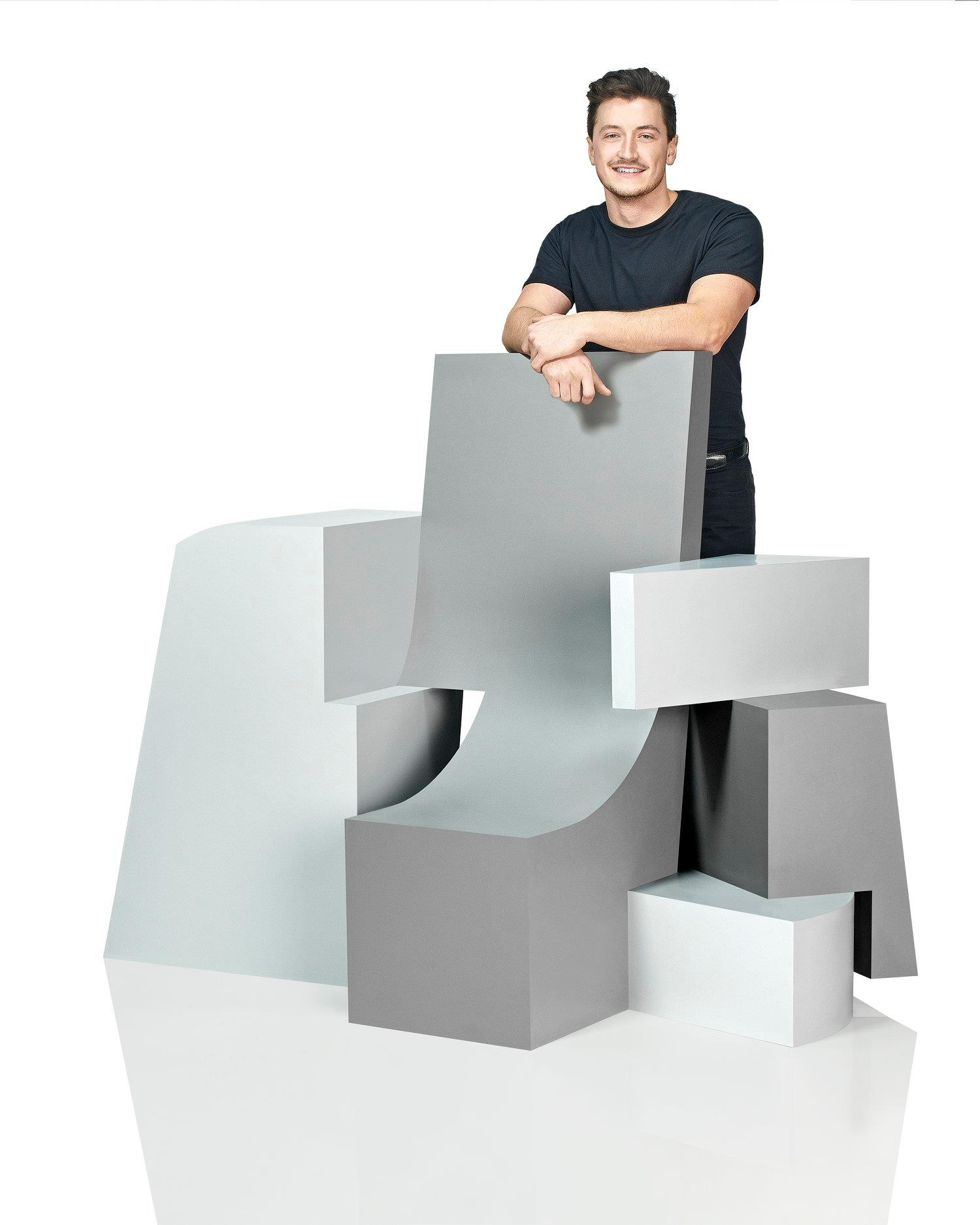 Student Greg Genter posing with his chair design