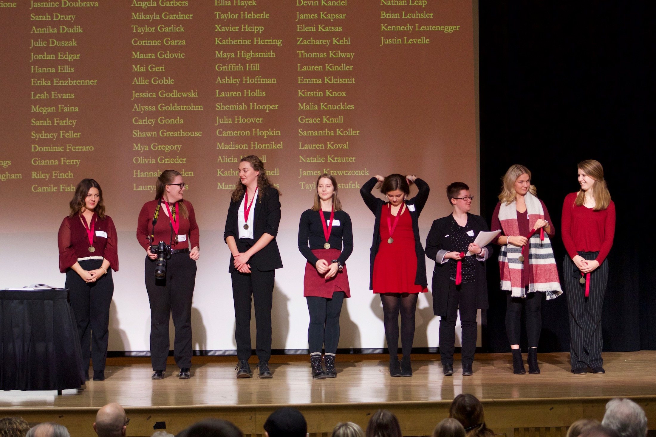 Officers of Alpha Lambda Delta, as they are presented with medallions.