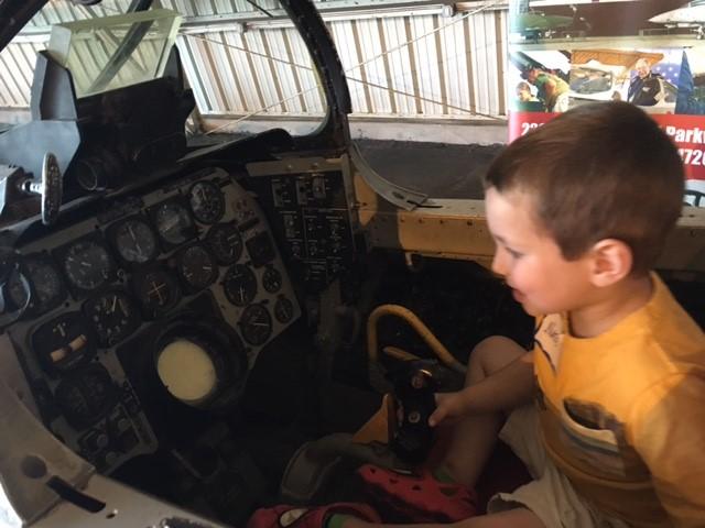 2016 Aero Fair attendee explores an F-86 Sabre cockpit