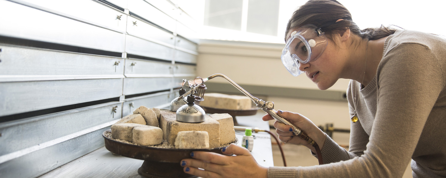 Jewelry/Metals/Enameling student soldering a ring