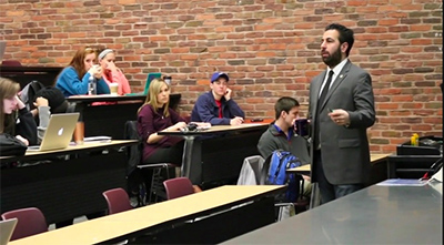 Limperos teaching an introductory communications course at the University of Kentucky.