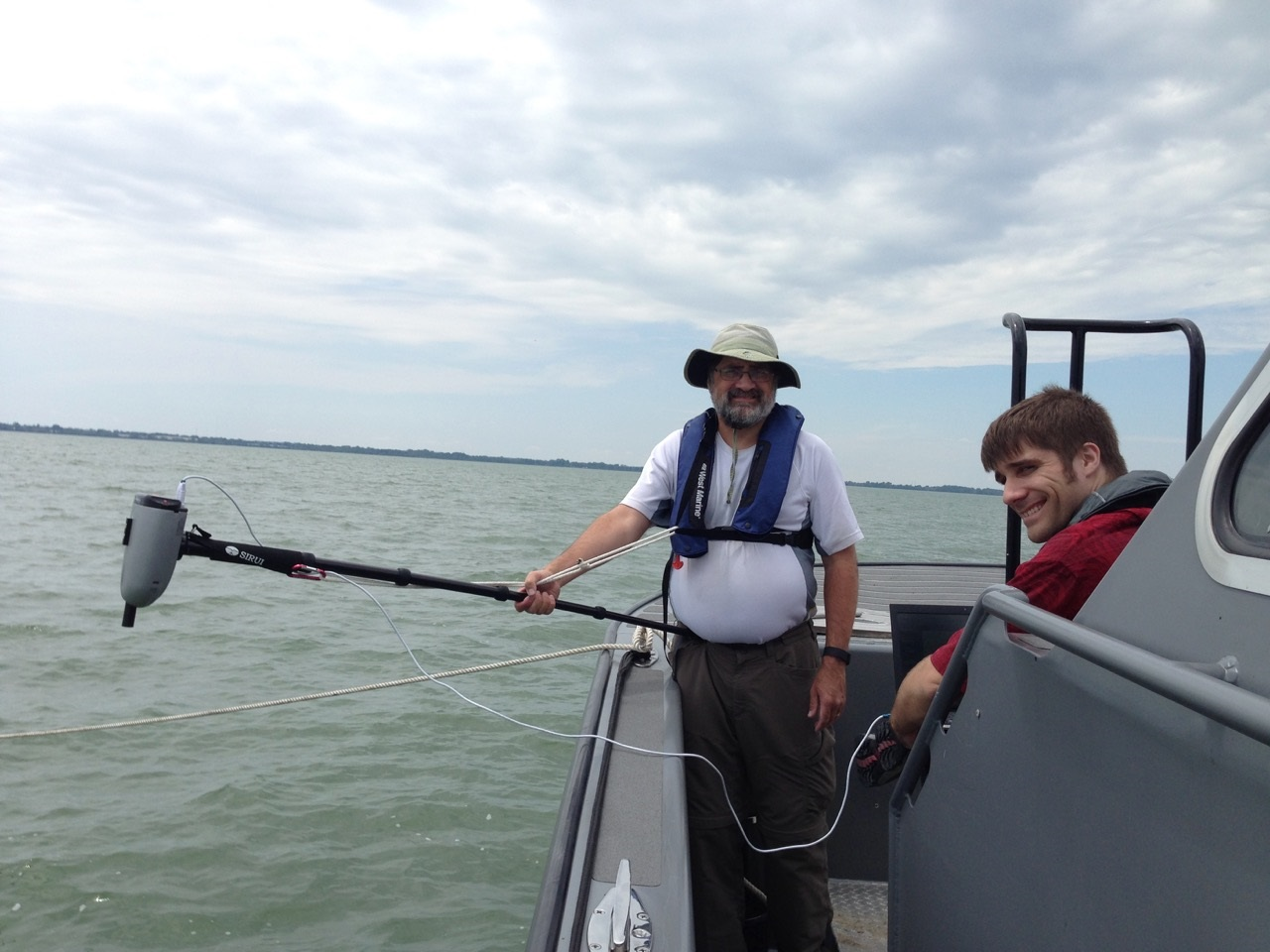 Kent State University Geology Professor Joseph Ortiz, Ph.D., and student Andrew Congdon collecting measurements of surface reflectance in Sandusky Bay (Photo credit: Sunny Dickerson, Bowling Green State University)