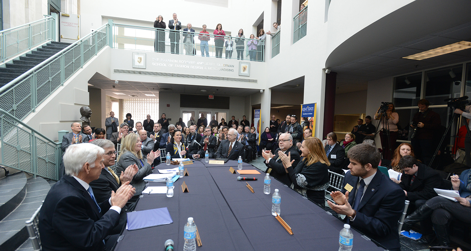 Members of the Kent State Board of Trustees clap in recognition of the unanimous vote to elect Dr. Beverly J. Warren as the 12th president of Kent State University.