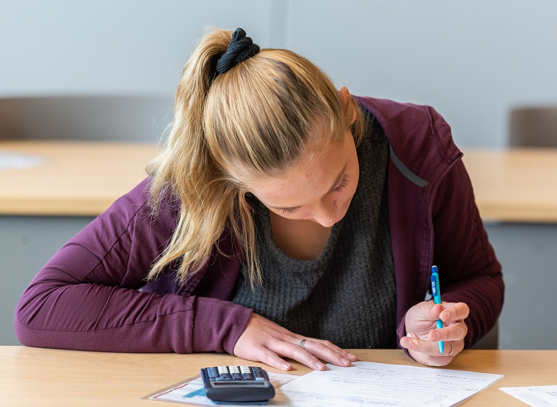 A student studying at a desk