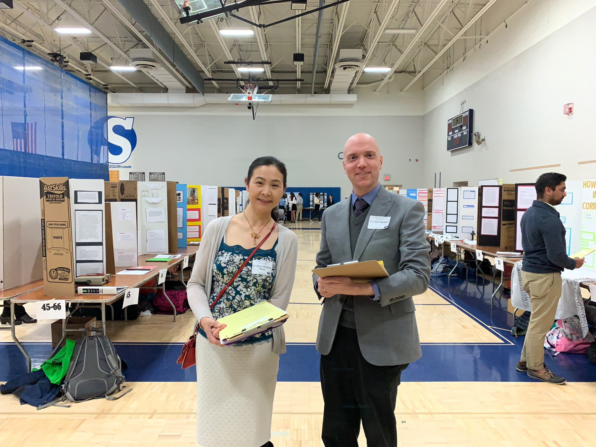 Drs. Wang and Weigold judging a local student event