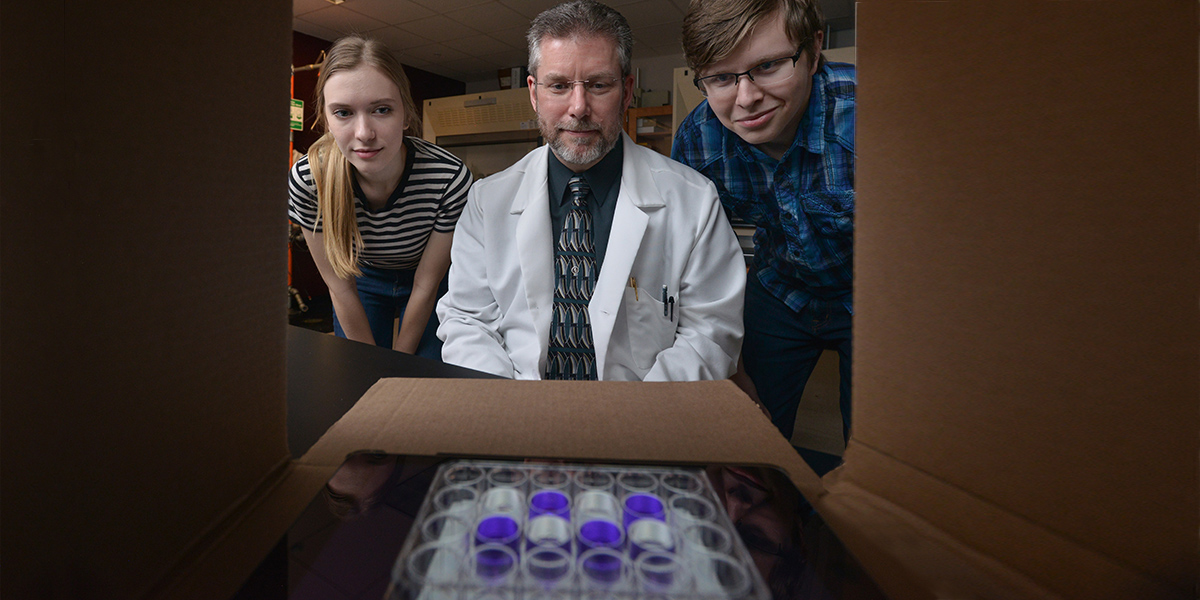Kent State Professor uses cardboard boxes, cellphones and bubble wrap to cut the cost of expensive lab equipment.