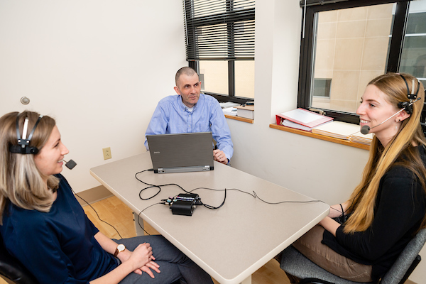 Kent State professor John Gunstad and his research assistants Hanna Schmetzer and Victoria Sanborn demonstrate using the voice pattern technology that is part of his Alzheimer's disease research.
