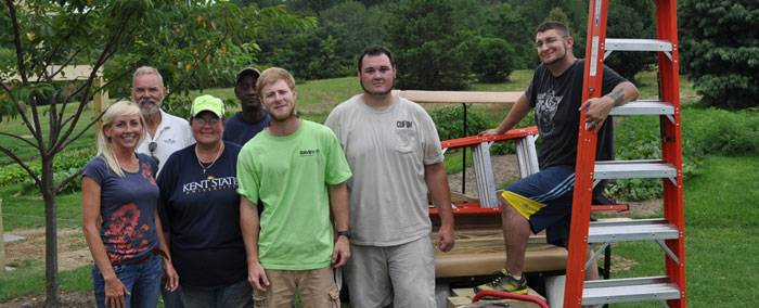 """Horticulture students in the landscape design classes are """"studying"""" outdoors these days, as they design and build structural features for the Discovery Garden on the Salem campus."""